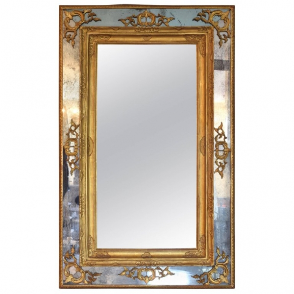 Carved Giltwood and Embossed Gilt-Gesso Mirror