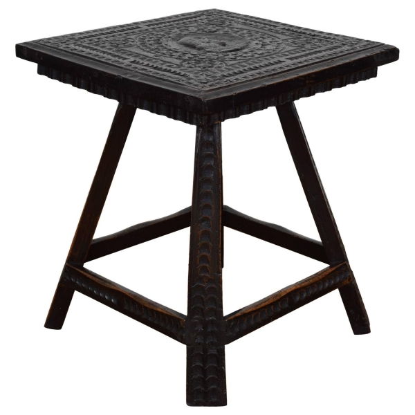 Carved and Ebonized Side Table