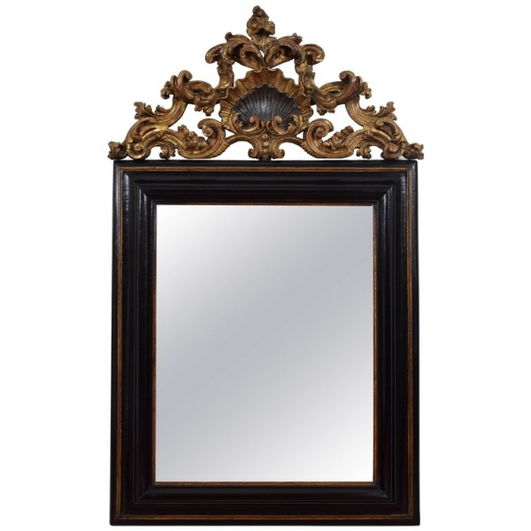 Exceptional Ebonized and Carved Giltwood Wall Mirror