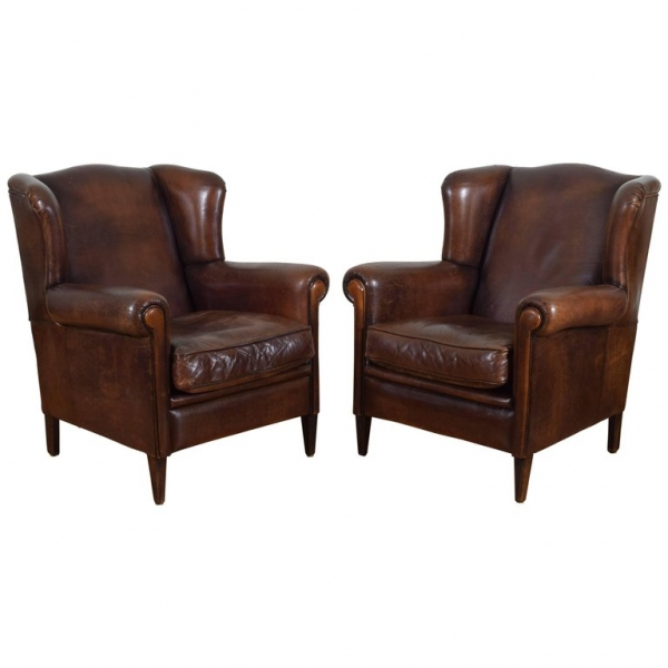 Pair of Leather Upholstered Wingchairs with Piping